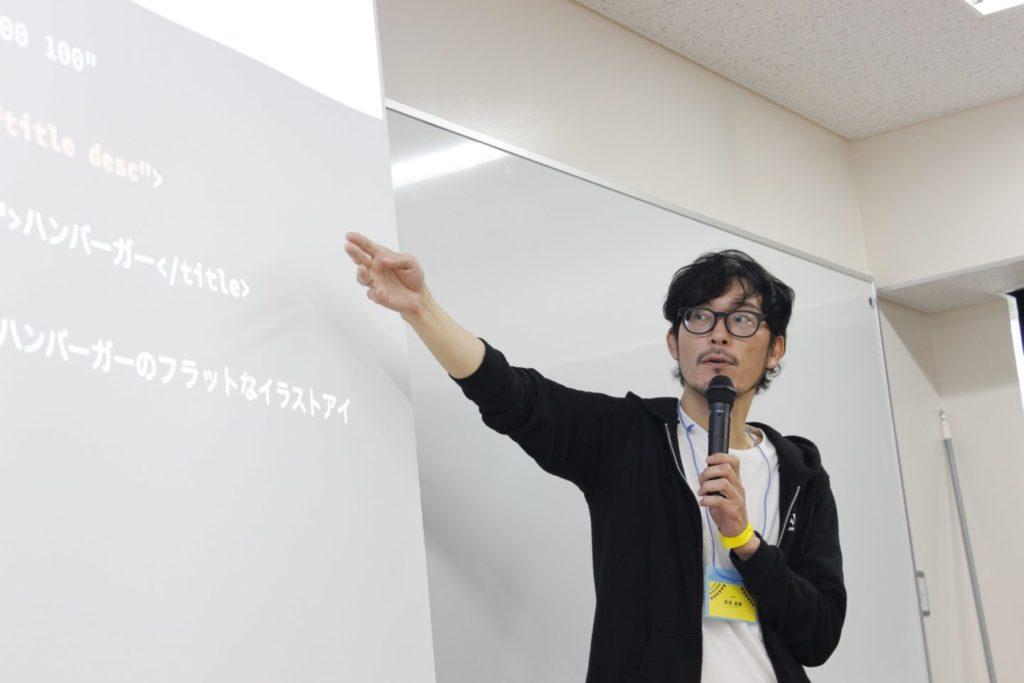 写真:スライドを説明する松田さん